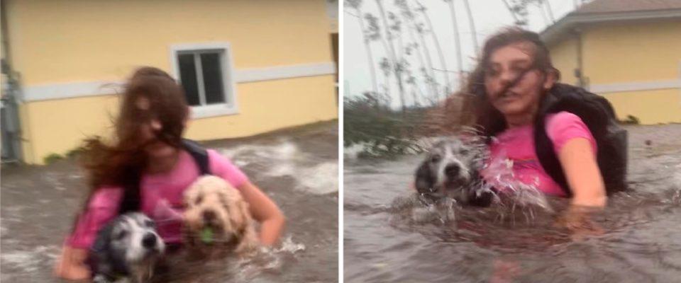 Uma jovem não solta de jeito nenhum seus dois cães no meio de um furacão