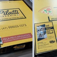 Pizzaria no Brasil adota ideia de colocar fotos de cães para adoção na caixa de pizza