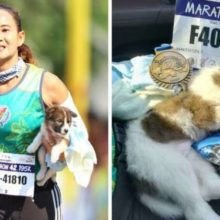 Mulher termina a maratona carregando um cãozinho perdido que resgatou durante a prova